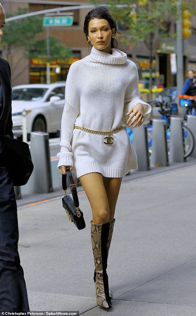 c2a8086a58aa Bella Hadid cuts a chic figure in turtleneck dress with snakeskin boots and  Chanel belt in NYC