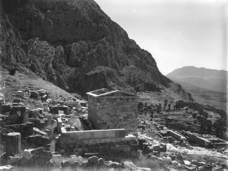 https://flic.kr/p/VzBa3T | Treasury at Delphi NM2007.84.7 | This photograph was taken by Nicholson Museum curator William J Woodhouse in Greece between 1890 and 1935.  Can you help us catalogue the Woodhouse photographic archive? Contribute by adding tags and answering the following questions in the comments below: •What do you see? Write a brief description for this image. •Where was this photograph taken?  •Can you find the geo co-ordinates (latitude and longitude) of this exact place? Let…