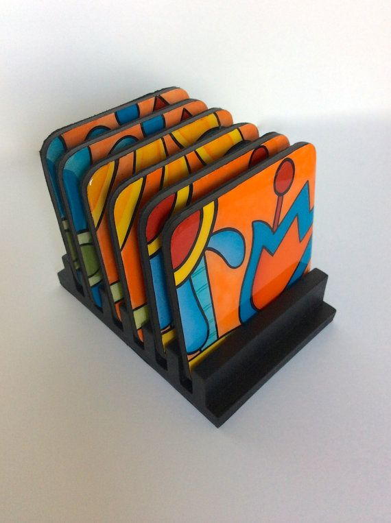A set of 6 wood coasters. The coasters are 100% hand painted . Every coaster is painted on wood with acrylic colors.This wooden base and coasters comes painted in bright colors . After the wooden base and Coasters are hand painted, they are coated with a clear resin layer to seal and protect the painting. Each piece is original and created in our studio . Colors may vary slightly due to computer differences. Wipe clean with a damp cloth. Do not put in dishwasher or do not immerse in water…