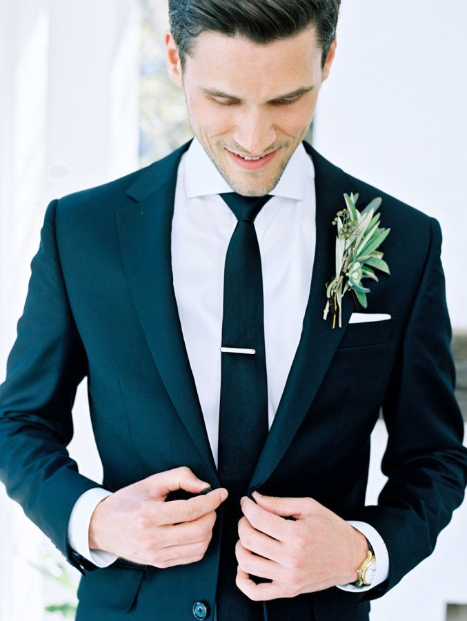 Groom in a classic black suit: http://www.stylemepretty.com/2017/03/13/organic-watercolor-florida-wedding/ Photography: Lauren Kinsey - https://www.laurenkinsey.com/