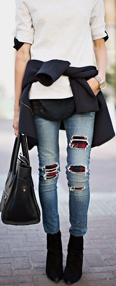 hmm, I actually am loving the idea of wearing a bright/patterned tight under ripped jeans!: