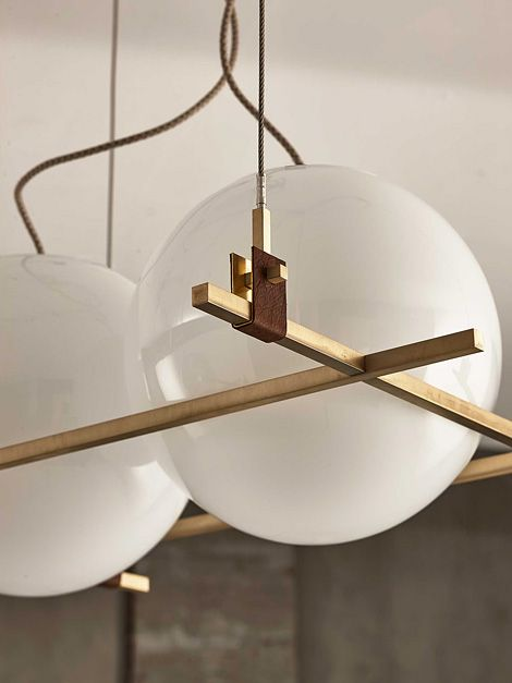 Lighting in brushed and burnished brass and leather from milan based designer federico peri