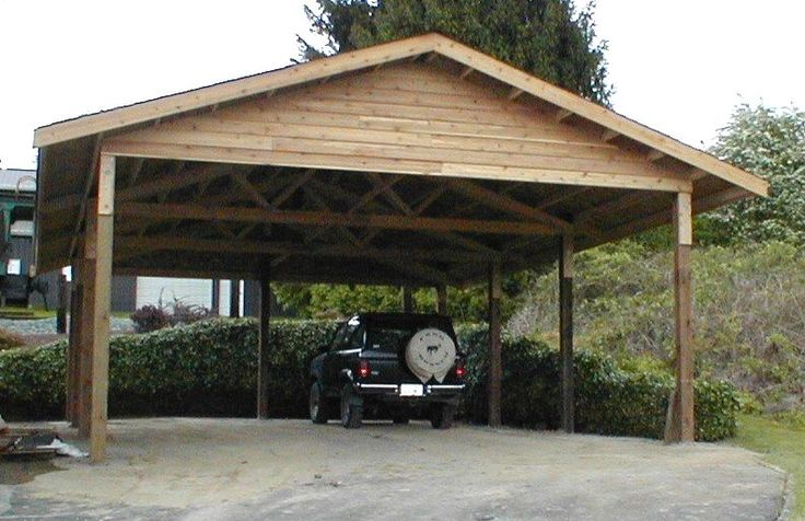 Wooden carports 24 x 36 cedar carport attached carport for Garage pole cover