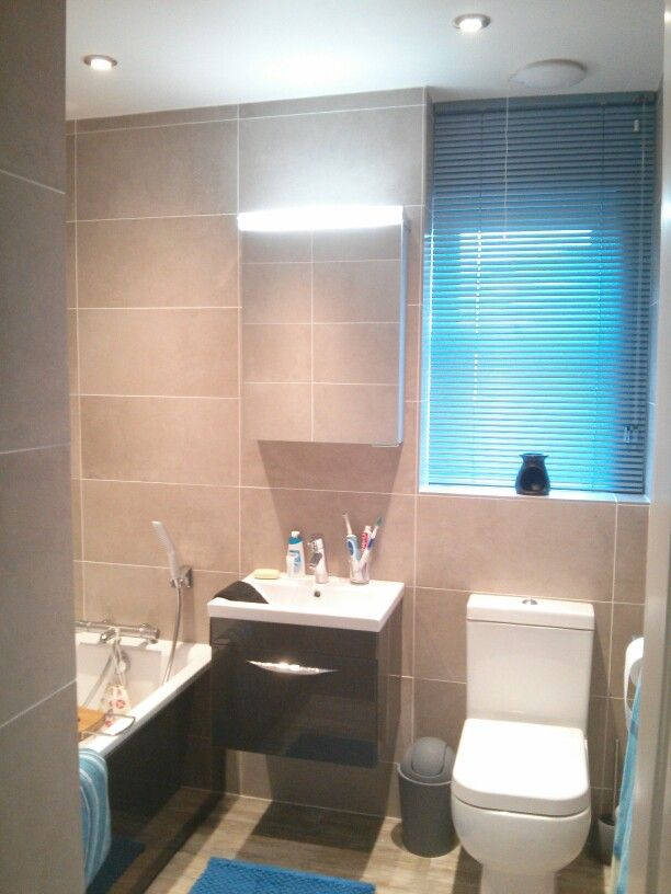 Small, family bathroom.