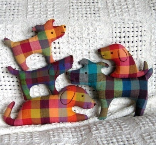 Dog family softies -- a close look. These are no longer available for sale on Etsy, but the patterns have been made available and you should be able to get it at the pin next to this one.