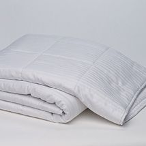 Hi Loft is a premium cotton product made from washable, all new, long fibre Australian cotton. Due to the special carding process used in manufacture it is loftier than other cotton with the same weight. It is more breathable, luxuriously soft and lightweight. The cotton quilt consists of 350gsm hi loft Australian washable cotton and has a 1cm stripe sateen cotton cover with binding edge. It is luxuriously soft and lightweight.