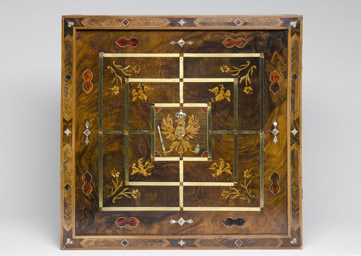 A German ebony, wood, mother-of-pearl and brass game board, c.1720-30, with the heraldic eagle emblem of Frederick the Great, King of Prussia (1712-86). (Philadelphia Museum of Art)