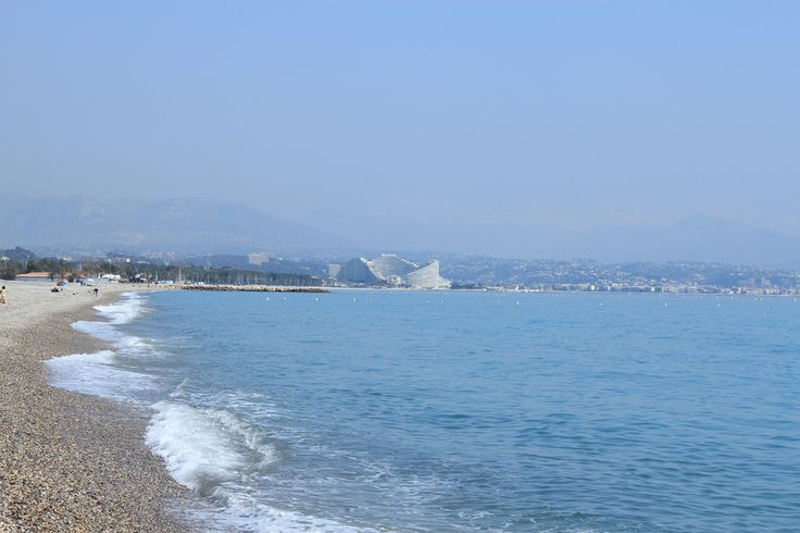 Marina Baie des Anges (in the distance) on the beach in the South of France (near Nice).