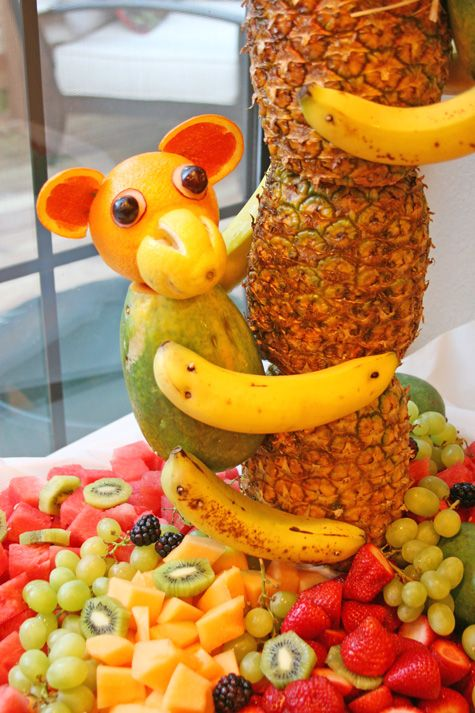 I've make the tree before, but not the monkey! monkey made out of fruit on a pineapple tree