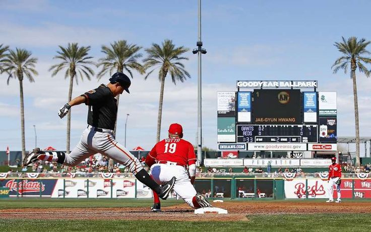 Giants-Dodgers tickets plunge to $6 after brutal start  -  April 24, 2017 Cincinnati Reds first baseman Joey Votto (19) makes a catch at first base for an out against San Francisco Giants third baseman Jae-Gyun Hwang, left, of South Korea, during the second inning of a spring training baseball game, Sunday, Feb. 26, 2017, in Goodyear, Ariz. (AP Photo/Ross D. Franklin)