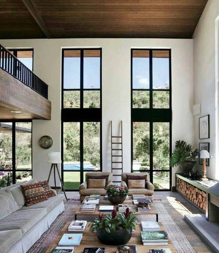 Home Design and Decor , House High Ceiling Designs : High Ceiling Designs Living Room With Sofa And Side Chairs And Double Coffee Table And Vertical Windows An Tripod Floor Lamp And Ladder And Wall Art