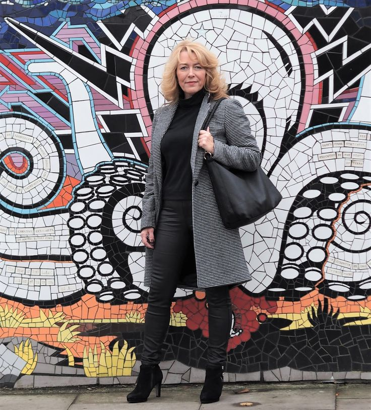 Over 50s blogger Laurie Bronze from Vanity and Me in black ankle boots for the 5 Over 50 Challenge These Boots were Made for Walking