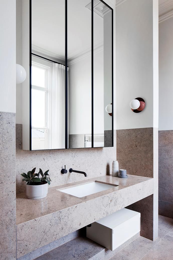 A custom mirror in the main ensuite and a wall light in antique bronze by Izé. Photo: Shannon McGrath  | Story: Belle