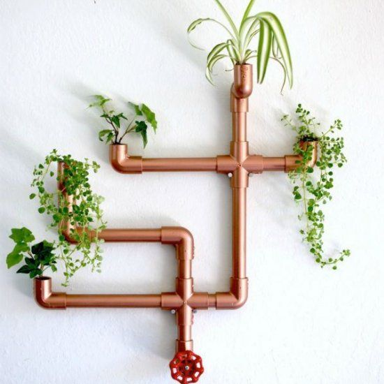 This DIY wall planter is not only functional but makes for a great conversation piece, and has the appearance of a modern art installation.
