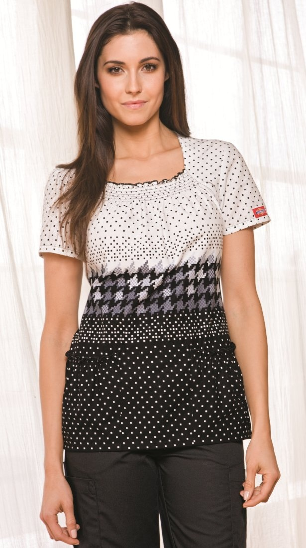 A Junior fit square neck top features a marrow edge and smocking around the neckline and patch pockets. Side vents and back fish eye darts complete this top.