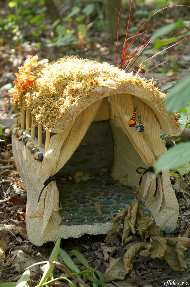 fairy house with glass marble floor...Looking at this and thinking would make a really easy gypsy vardo