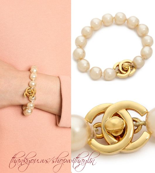 This authentic vintage Chanel bracelet is composed of a strand of rich imitation pearls, and a gold-tone, logo turn-lock clasp tips the ends.