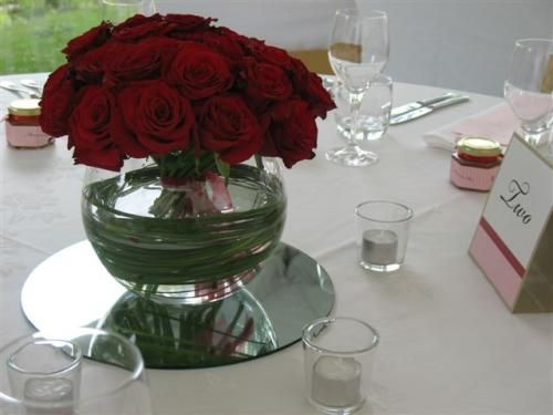 Red roses in fishbowl twisted with beer grass