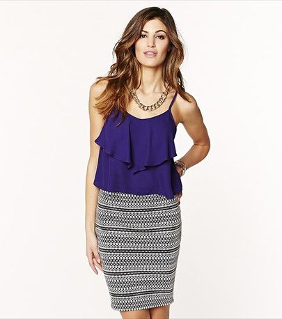 Look sweet and chic with this purple ruffled cami! Looks fabulous paired with one of our high waist skirts.