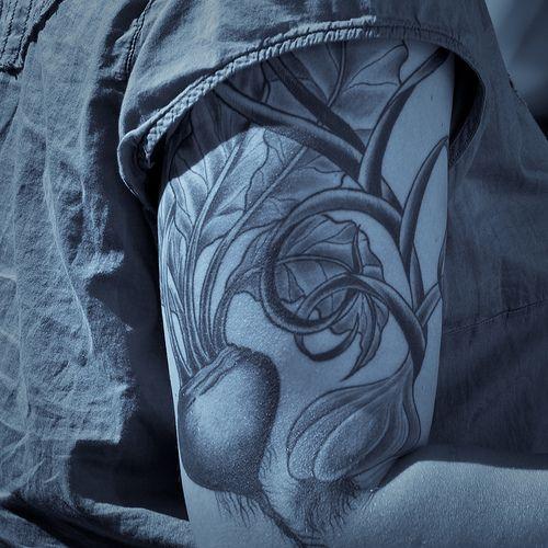 Garlic Tattoo On Biceps