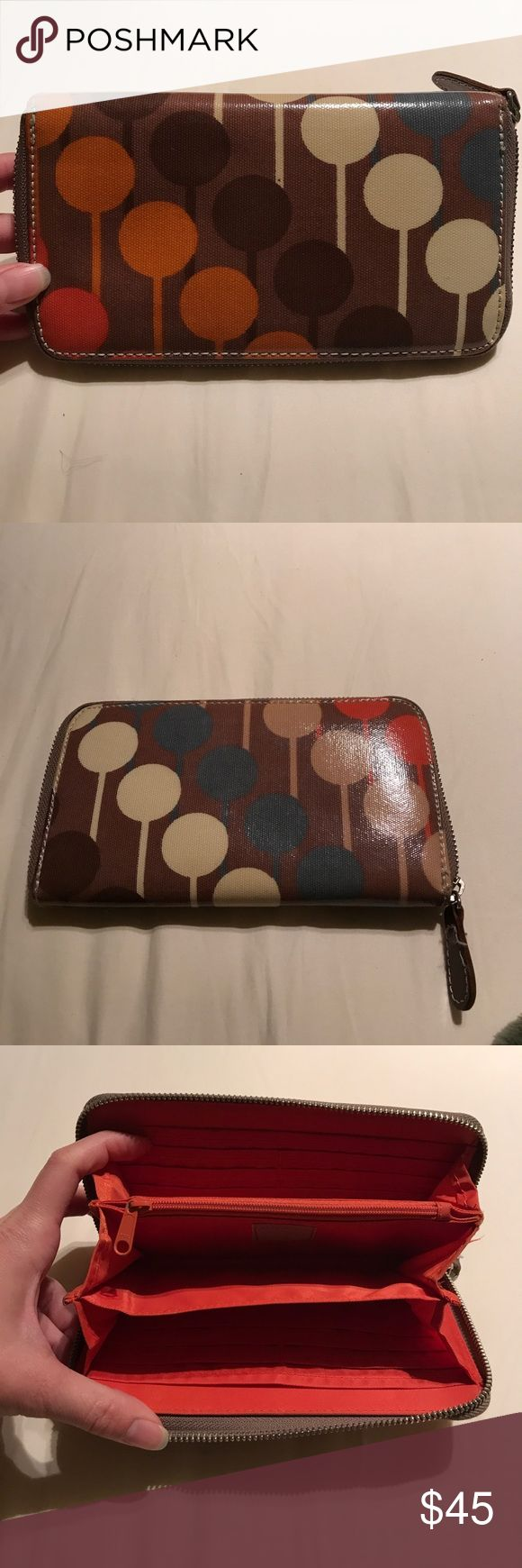 EUC Orla Kiely wallet EUC Orla Kiely wallet in the lollipop design. No signs of wear.  Minor dirt on the inside zip pocket from change.  Excellent condition! Orla Kiely Bags Wallets