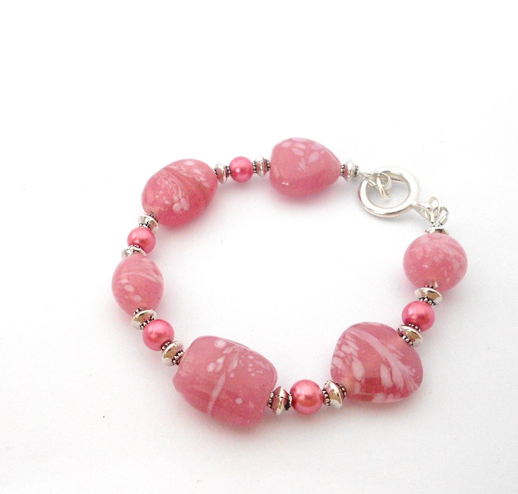 Pretty pink bracelet with glass beads and silver plated toggle clasp.