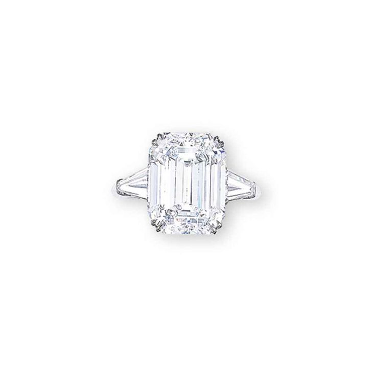 AN IMPORTANT DIAMOND RING, BY HARRY WINSTON  Set with a rectangular-shaped diamond weighing 8.88 carats, flanked by tapered baguette-cut diamonds, mounted in platinum, ring size 6¼  Signed Winston for Harry Winston