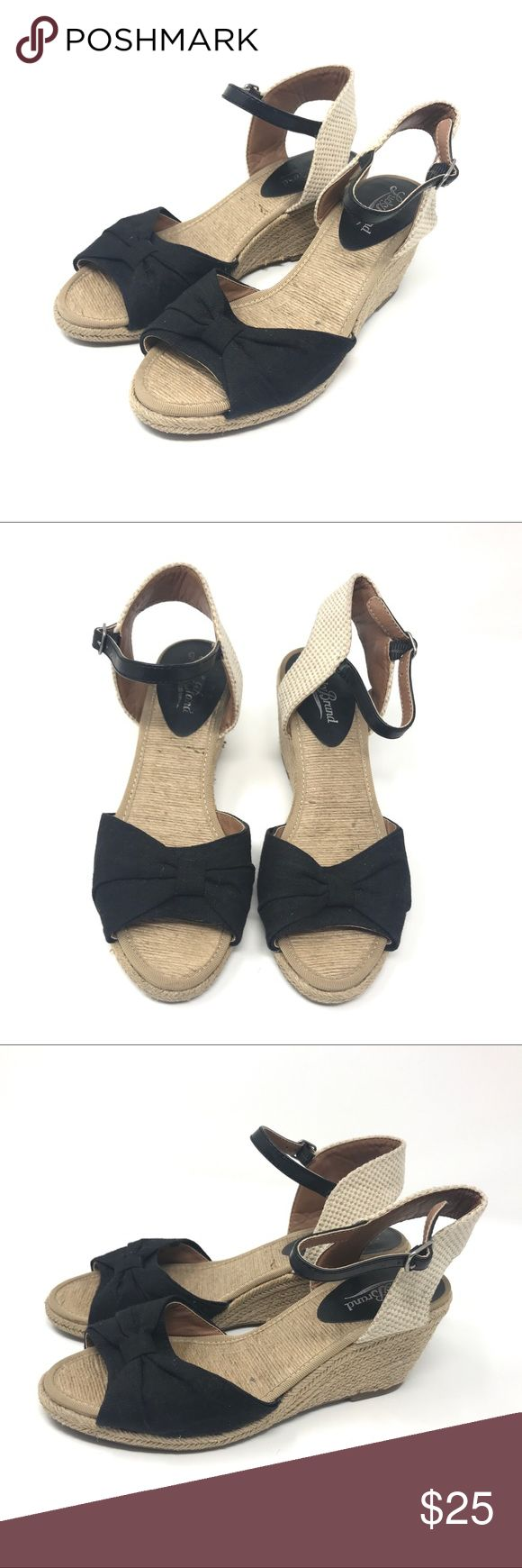 Lucky Brand Black Espadrille Wedge Sandals Black espadrilles with a wedge heel and ankle strap. Contrasting heel strap.  Open toe with bow ties / wrap on front bands.   100% authentic Lucky Brand Women's Shoes    Color:  Black & Tan throughout    Size:  Women's 6     Condition:  Excellent; barely any visible wear. Logo is partially rubbed off from removing sticker, otherwise no flaws.  No major flaws or imperfections. No stains, holes or heavy wear. Please see all photos as a visual…