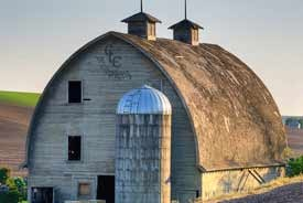A BARN with TWO CUPOLAS & A SILO. -  It Reminds Me of a Ships Bottom House.