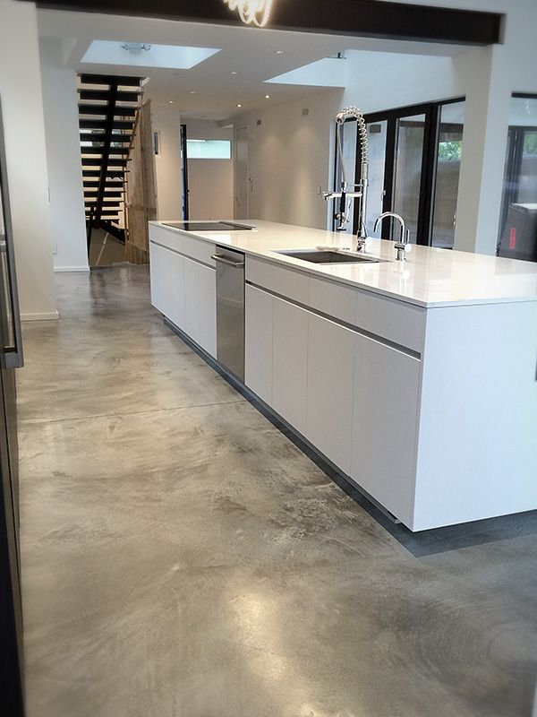 The variation in these burnished concrete floors comes from the swirling motion of the burnishing pad. As long as your floors are newer or in good condition, you can take an unfinished concrete floor and burnish it into a glossy, interesting surface for a fraction of the price of a full polish.