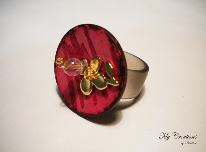 caoutchouc ring (wood and metal flower)