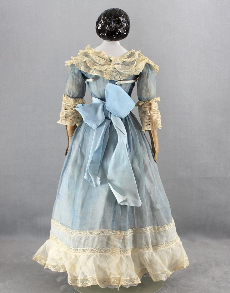 c1860s china head portrait lady doll known by collectors as 'Mary Todd Lincoln', circa 1860, 22-1/2 inches tall. This particular head is avidly sought