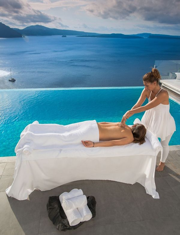 Wouldn't you love to have a massage with a view? At the Santorini Secret Suites & Spa, you can have just that!