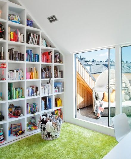 If I ever buy a place with a beautiful sloping roof like this one, I will build shelves just like that. via skonahem, via apartment diet.