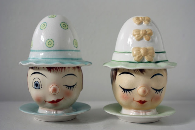 So he's flirting and she's demure!  So many egg cups when the female has her eyes closed.  Someone explain this phenomenon to me.  These might be a pair of Italian egg cups.  Saucer, cup and cozy.