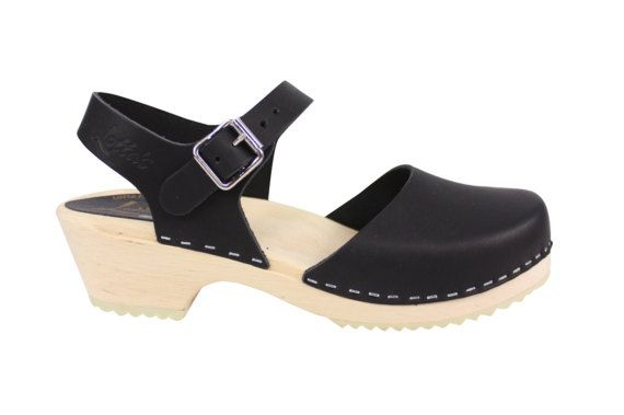 Built on a classic clog base these low-heeled clogs are a delight to wear at any time of year and look wonderfully cute.  A classic design handmade in Sweden  A 5cm heel provides enough height to allow the properly shaped footbed to be formed which includes both a pronounced arch support and a big toe indent for easier walking.  Lotta low heel clogs do come up larger than the high heel so we do recommend going down a size from your usual size, unless you have particularly wide feet then…