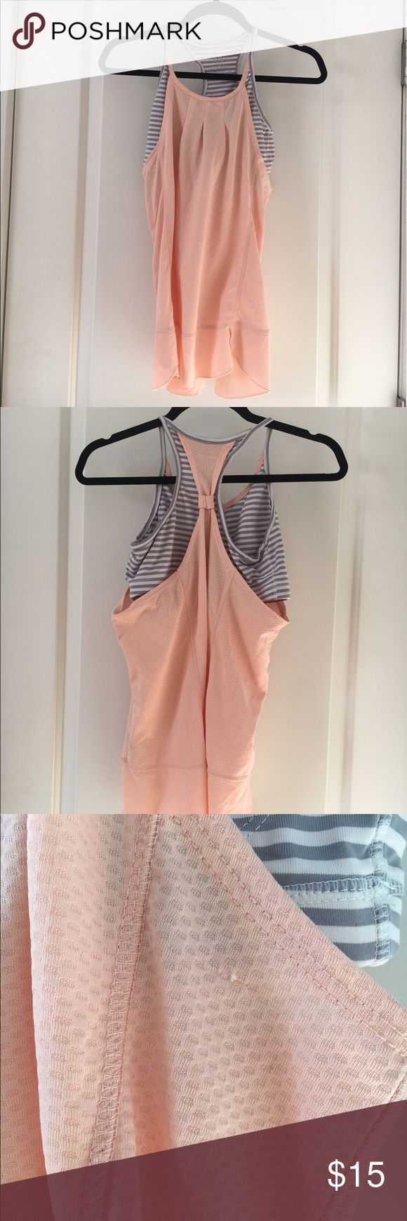 """White & grey striped sport bra with attached tank Grey and white stripes sports bra with attached light pink tank. Slightly worn. Few snags (as shown in picture). Measurements: 26"""" long; 18"""" pit to pit on tank; 14"""" pit to pit on sports bra. MPG Tops Tank Tops"""