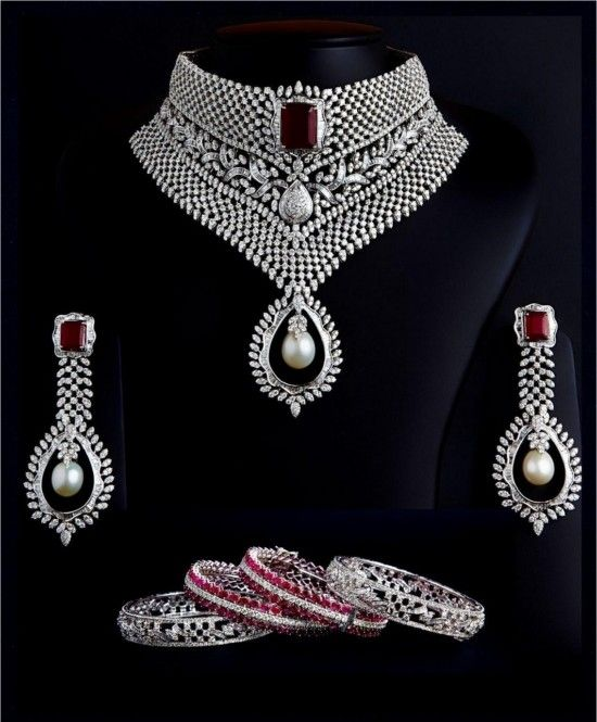A Multi-Wear Diamond Choker Set Studded With Round Diamonds, Tappers Baguettes, Rubies And A South Sea Pearl Added As A Droplet With Matching Designer Ruby Pearl Diamond Earrings And The Exclusive Matching Designer Ruby Diamond Bangles. A Complete Bridal Diamond Jewellery Set By Kuber Diamonds.