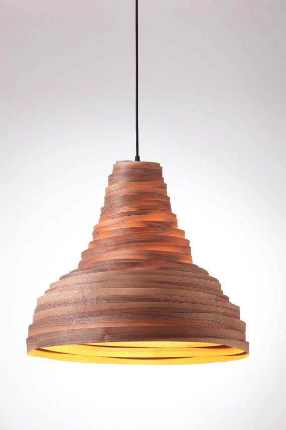 A whirlwind of veneer. Built of a stripe of veneer that climbs in a whirlwind motion, swaying around its center. The silhouette is our organic version, reminiscence to a classic industrial lights shape Material: Wood veneer, Black Walnut. Also available in maple, cherry or bamboo veneer.  Dimensions: height/ diameter: Large: 50/58 Medium:40/45 Small: 26/37  E27 light fixture, compatible with incandescent, LED and compact fluorescent bulbs.  The product is suitable for indoor use only. Two…