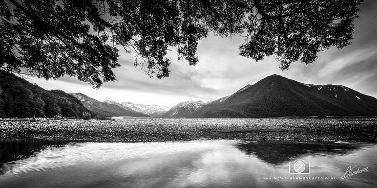 Black and white photo of mountains at Arthurs Pass reflected in the Waimakariri river