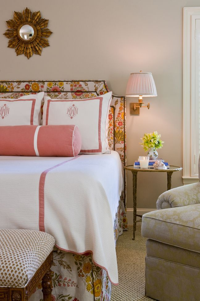 gorgeous room. floral headboard and matching skirt. monogram linens