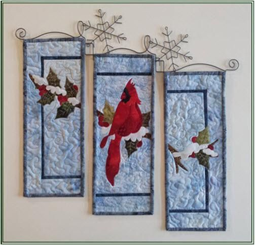 The Beauty of Winter Cardinal quilt.  I've always have liked these 3 type quilts but I love that quilt hanger too!