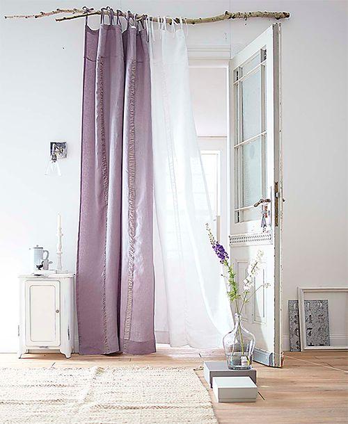 Preciosa barra de cortina con rama de árbol.