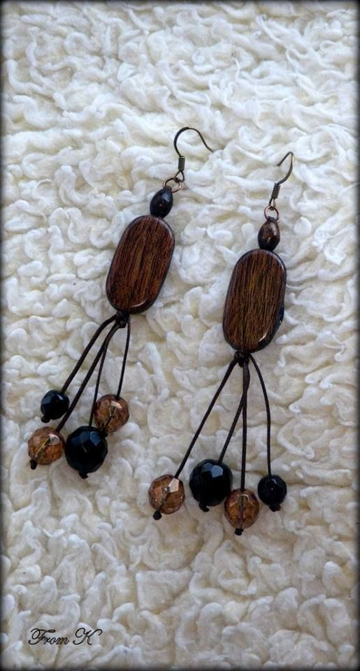 Black and brown Boho earrings. These wood earrings are simple, yet elegant enough to be worn on many occasions. Made by connecting wood bead with glass Czech crystals with a wax black string. About 6 cm long with the ear piece.