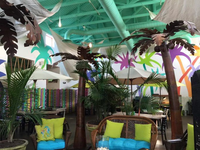 """Locally owned and operated in one of the """"coolest"""" towns in Kentucky, Flamingo Row brings tropical-themed fun to our landlocked state. The mint exterior and bright interior will whisk you away immediately and you'll be charmed by this festive dining spot."""