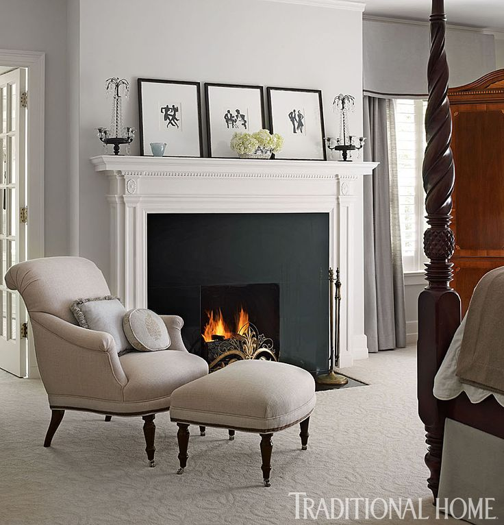 striking black fireplace surround makes a statement with a simple classic white mantel