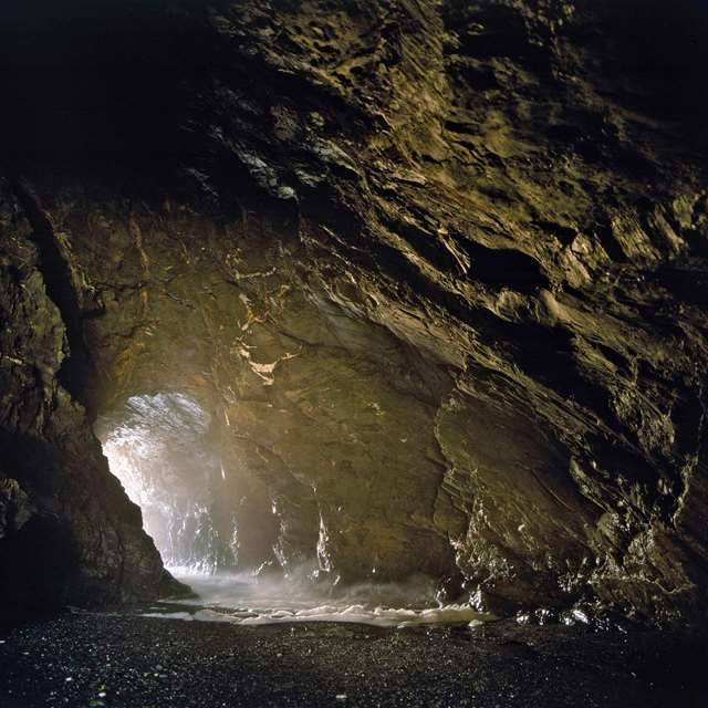 Tintagel, Cornwall. The cavern on the west side of the Haven beach, which has been known since the late 19th century as Merlin's Cave