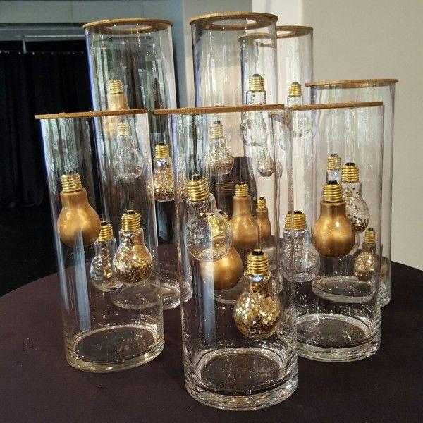 Golden lightbulb centerpieces ring lightbulbs