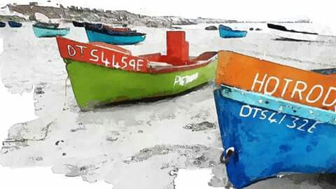 Colourful boats on the beach at Paternoster. West Coast, South Africa.