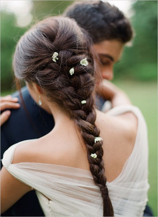 hair in braid with flowers for wedding
